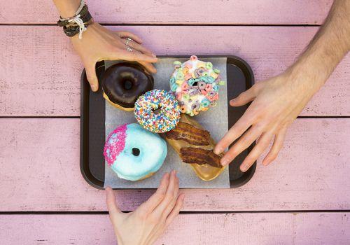 Specialty doughnuts on a tray.