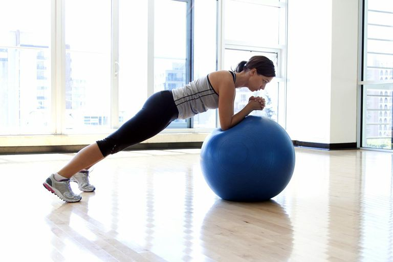 Woman doing plank on Swiss ball