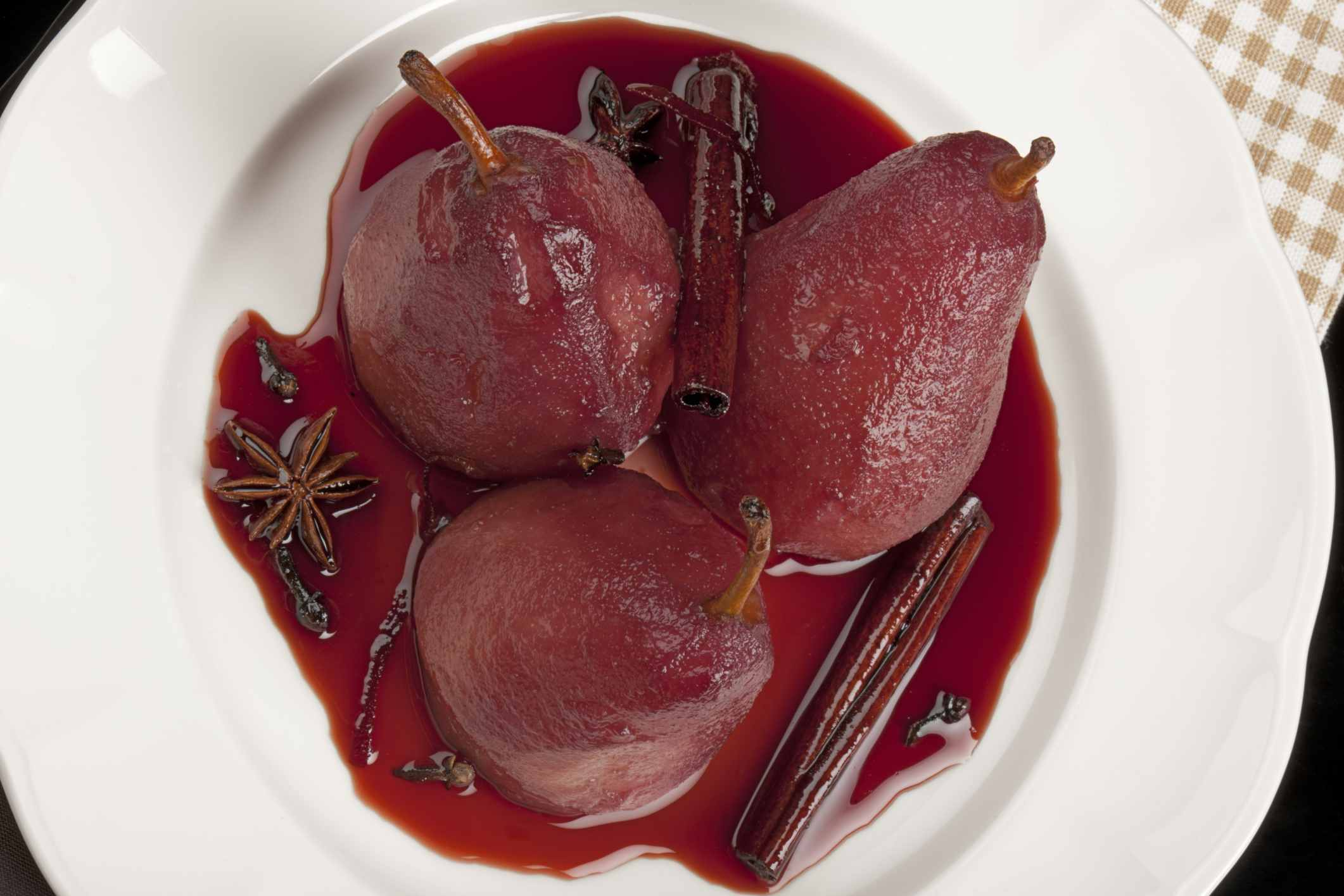 Poached pears are healthy holiday foods.