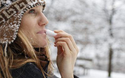 Woman using lip balm