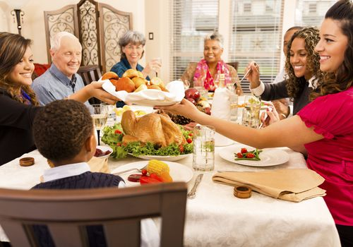 Family gathered around a table for holiday dinner