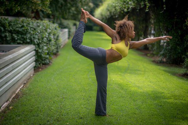 Woman doing yoga in sports bra