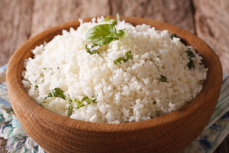 Cauliflower rice with herbs close-up