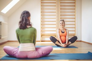 Pregnant woman at yoga studio