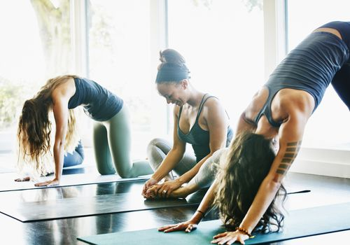 three women in yoga class