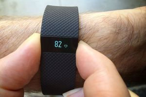person checking heart rate with fitbit