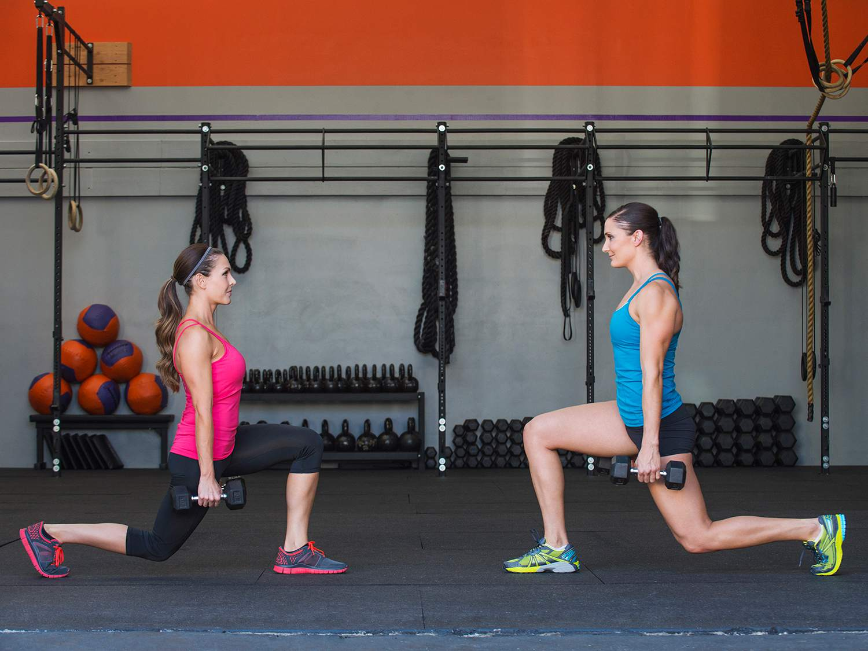 Caucasian women exercising in gym