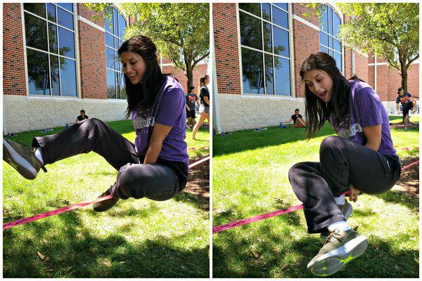 balance exercises on a slackline cross-legged sitting