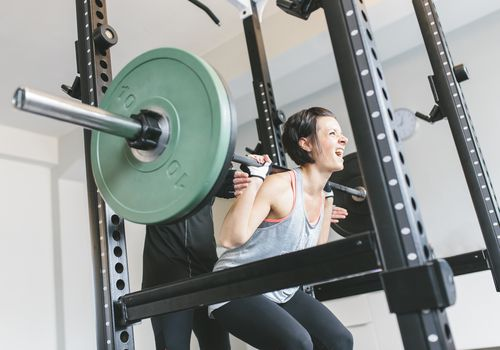 Woman doing Smith Machine Squats