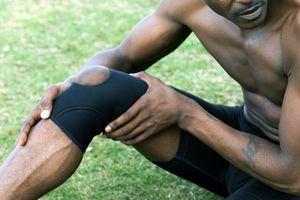 Male athlete wearing knee brace