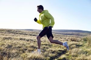 Man running in grassy field