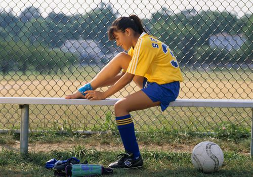 Soccer Girl Covering Her Ankle
