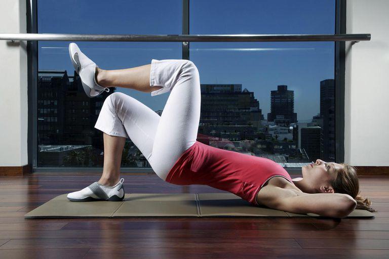 Woman practicing Pilates on mat