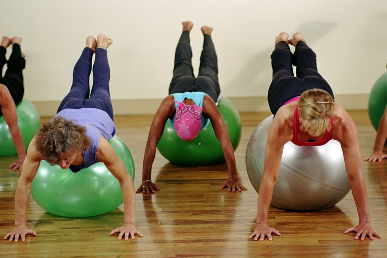 Using an exercise ball.