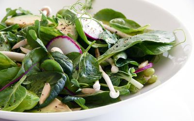 a green salad with radishes