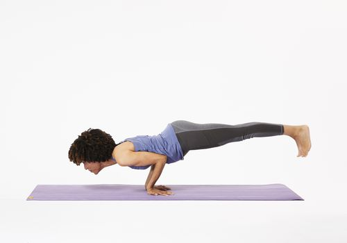 Woman in mayurasana pose
