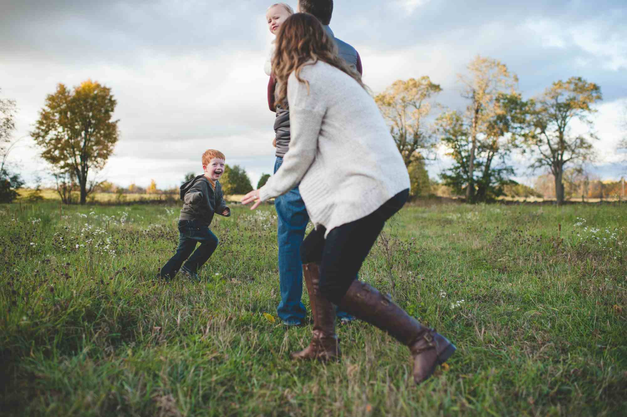 Family running around in a field