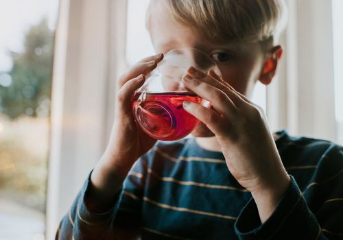 boy drinking fruit juice