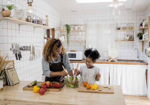 Woman and child making dinner