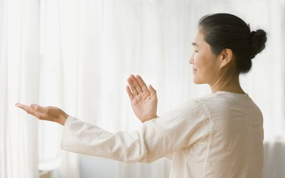 Asian woman practicing tai chi