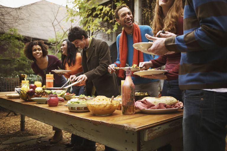 Friends eating food at social gathering