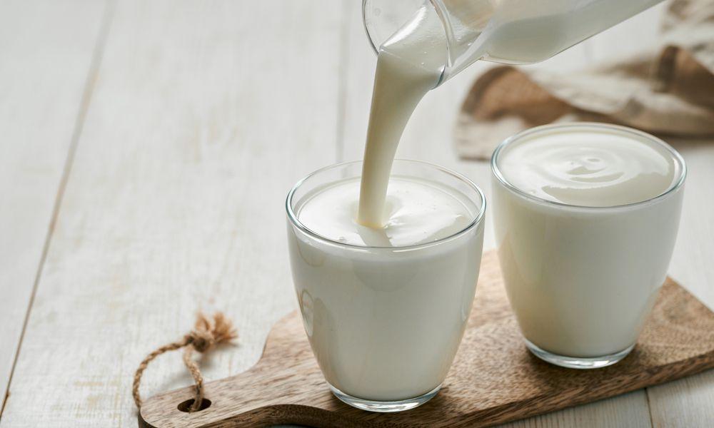Pouring homemade kefir, buttermilk or yogurt