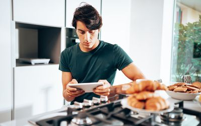 man using the tablet at home