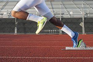 man starting running on running track