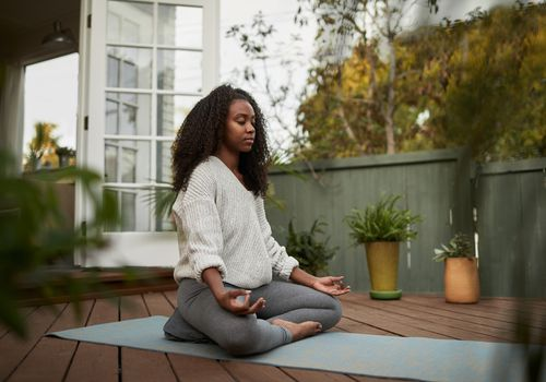 black-woman-meditating-outside