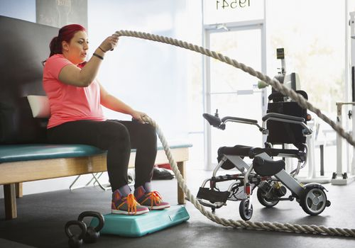 Disabled woman with ropes