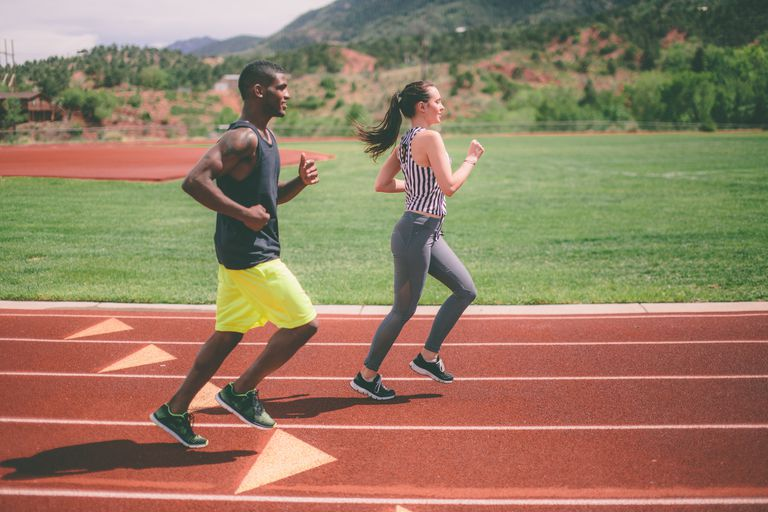 Man and woman running on a track