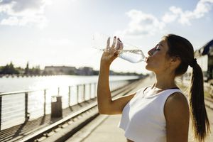 Woman running while drinking water