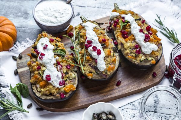 A Mediterranean dish of stuffed squash topped with tzatziki.