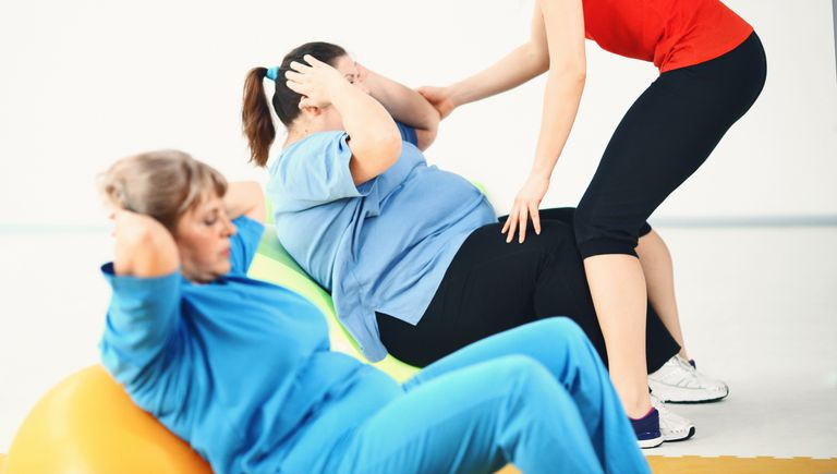 Overweight women on an exercise ball