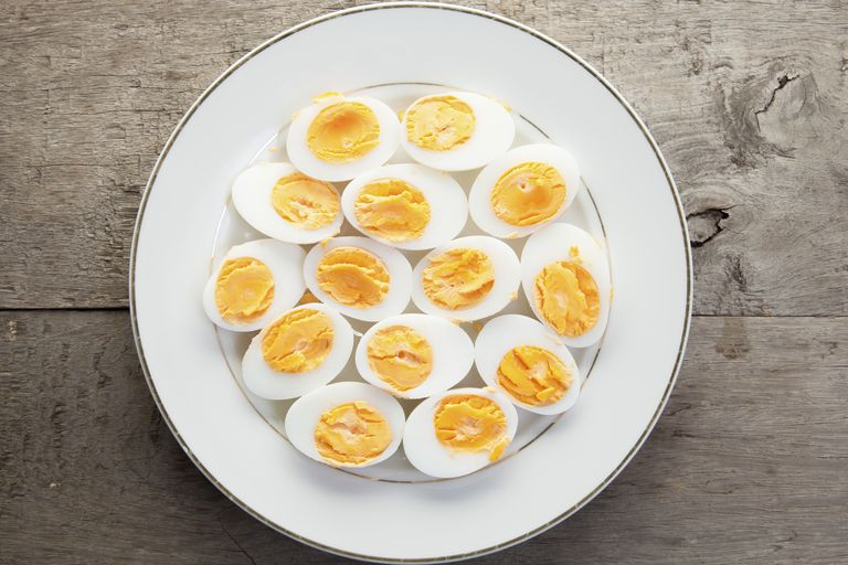 Hardboiled eggs on plate.
