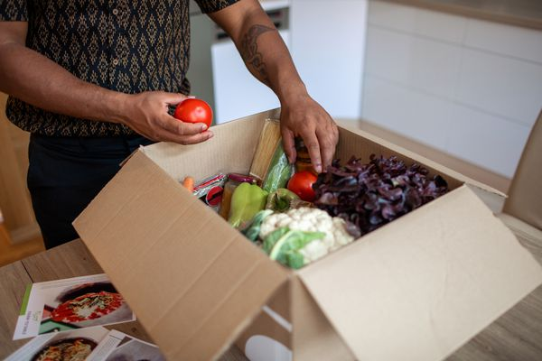 Man unpacking vegetable box