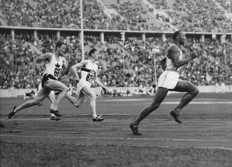 The American Runner Jesse Owens Running In The 200-Meter Sprint A New Olympic Record. Berlin. 4Th August 1936. Photograph.