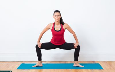 woman doing squatting groin stretch