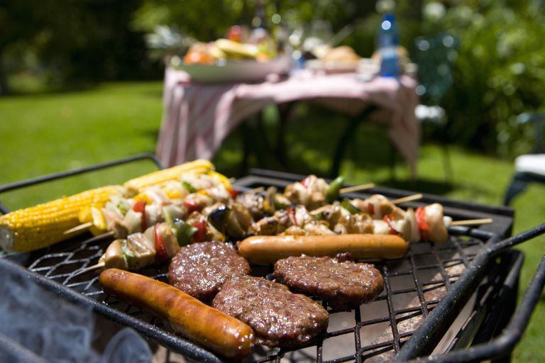 Burgers, hot dogs, and kebabs on the grill