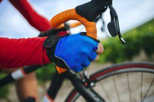 Close-up of hand cyclist on the bike handlebar