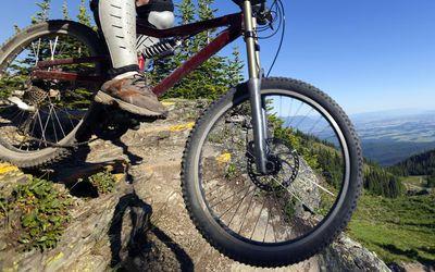 Man downhill mountain biking at Whitefish Mountain Resort in Northwest Montana