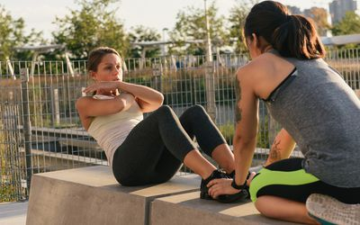 Two friends exercising together