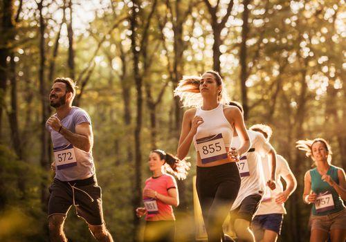 People running a half-marathon in a park