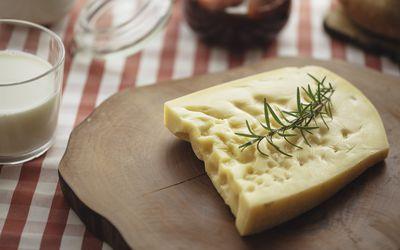 Gruyere cheese on a board