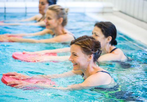Women taking a water aerobics class