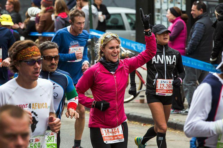 A woman runs the ING New York City Marathon on November 3, 2013 in New York City.