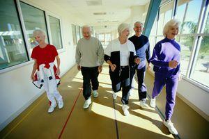 Seniors walking on indoor track