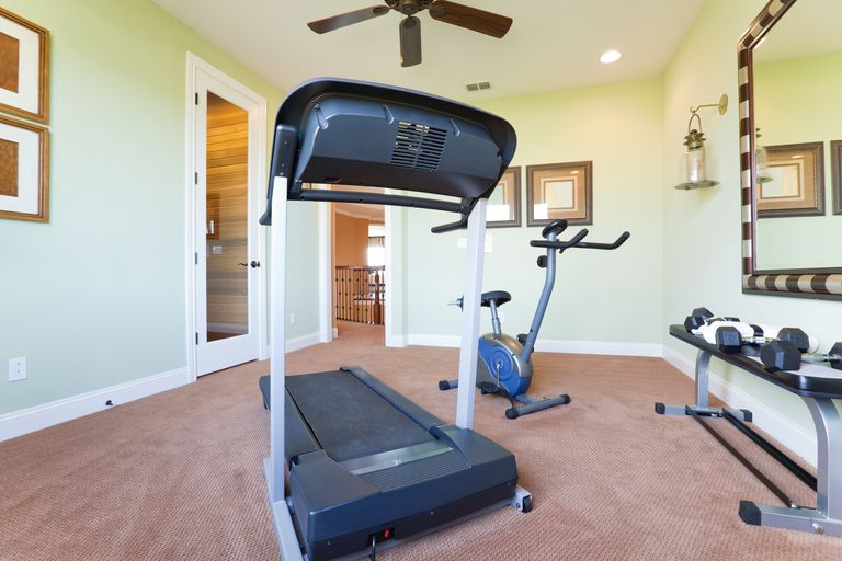 Fitness Room with treadmill, exercise bike, and dumbbells