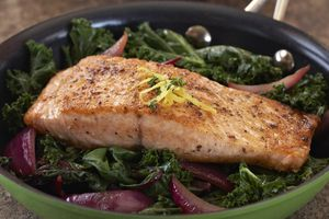 salmon with kale in pan