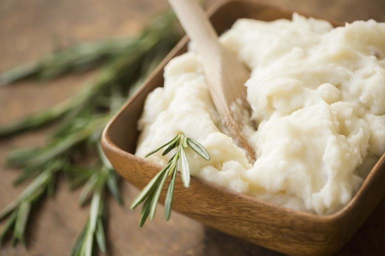 Close up of mashed potatoes and rosemary